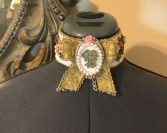 Pale pink beaded choker/necklace, with gold bow and handmade cameo style centerpiece-Victorian, costume, rococo