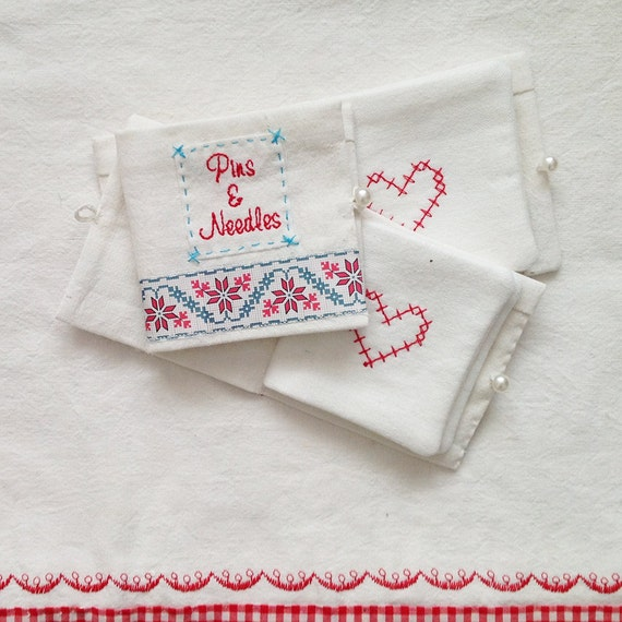 Needlecase with vintage linen, embroidery, cross stitch heart and Nordic style fabric tape