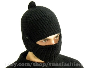 Knight's Helmet With Moveable Visor  The original and warm all black knitted cap in the form of knight helmet