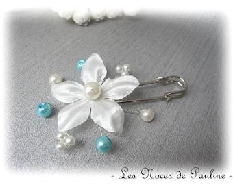 Fastener behind turquoise and ivory satin flower, wedding