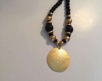 Gold medallion statement necklace.