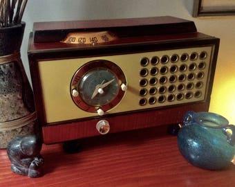 Crazy Philco Grommet mid-century clock AM tube radio.  Restored working.