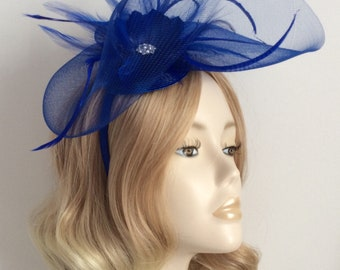 ROYAL BLUE FASCINATOR, Made of crin, feathers, all mounted on a matching headband