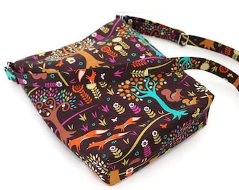 Whimsical forest theme large shoulder sling bag, crossbody hobo purse. Trees, foxes, rabbits. Chocolate brown and orange. Vegan.
