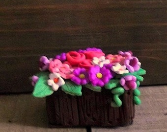 Flower bin polymer clay figurine