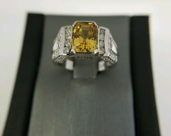 Gorgeous heated 3.02CT YELLOW SAPPHIRE ring set in 14k white gold with .76 diamond accents. Will adjust size at no charge!