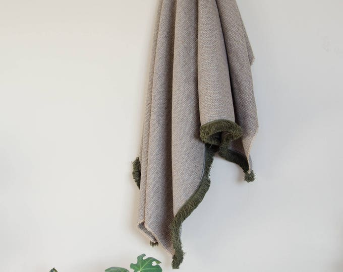 Handmade grey throw blanket with green trims