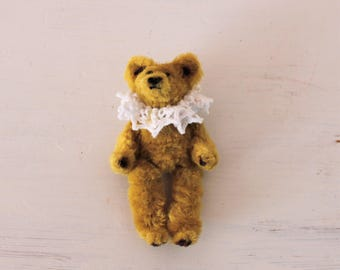 Miniature pipe cleaner teddy bear. Fully posable