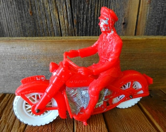 Vintage Auburn Rubber Company Police Cop riding Motorcycle