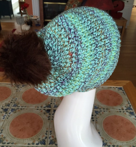 Striped Soft Green with Purple, Brown, and Gold Thread Hat with Mink Faux Fur Pom Pom