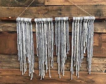 Grey & Oatmeal yarn hanging