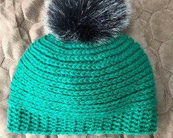 Child's crocheted Pom Pom hat