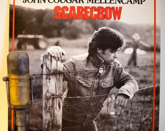 "John Cougar Mellencamp Vinyl Record LP 1980s Classic Rock and Roll ""Scarecrow""(1985 Riva w/""R.O.C.K. In The U.S.A."" & ""Lonely Ol' Night"")"