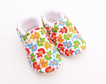 Sole leather baby shoes and white cotton top with colorful monkeys