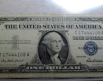 1957 blue seal Silver Certificate one dollar (#E61af)