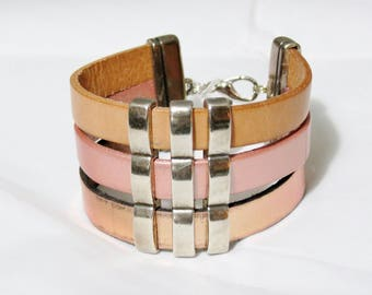 Cuff leather with silver metal loops.