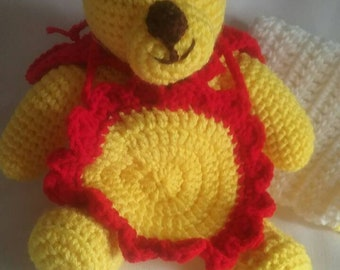 Super teddy with red cape, ball and burp cloth