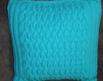 Turquoise wool upholstery cushion