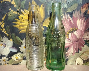2 Antique soda pop bottles Coca Cola and Orange Crush, the date on the crush is 1920