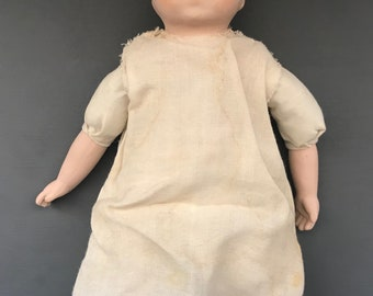 Vintage Bisque Baby Doll In Vintage clothing