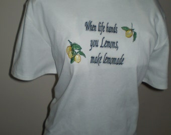 "T-shirt with  logo ""When life hands you lemons make lemonade""."