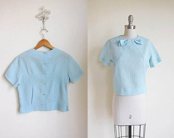 1950 vintage baby pale sky blue bow button down short sleeve blouse shirt top s