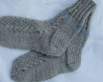 Grey hand knitted woolen socks