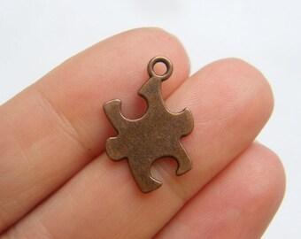 10 Puzzle piece pendants antique copper tone CC45