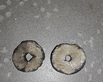 two thin beige raku ceramic discs