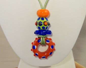 Artisan Glass bead necklace with bright orange, blue and green glass beads on metallic green leather cord