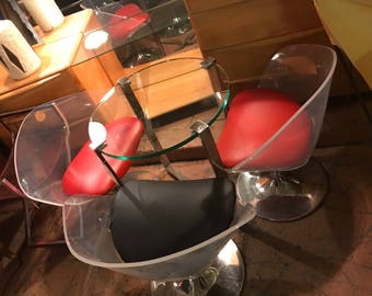 3 Lucite Tulip Chairs with a glass table