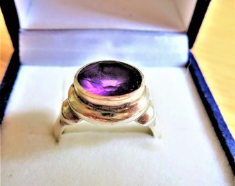 A vintage 925 silver and amethyst medieval style ring