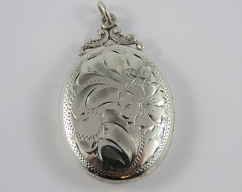 Sterling Silver Birks Oval Locket Pendant With A Floral Motif On The Front