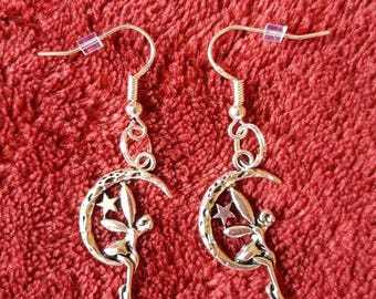 Silver Earrings with  Tibetan silver fairy charm.