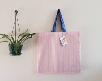 Large pink tote with blue handle