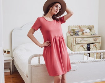 Short Sleeves Boat neck dress with slit opening at the back. Raspberry Pink or Gold Tencel Piqué.
