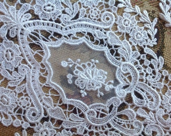 VINTAGE EMBROIDERED APPLIQUÉS. 2 embroidered white lace appliques flower designs.