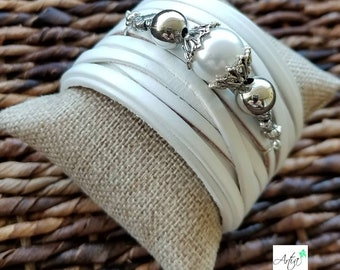 White leather cuff bracelet with beads insert.