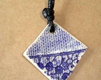 Cramic Pendant with Purple Flowers, Hangs on Dark Purple Cording, Handmade Ceramic Pendant, BOHO Design, 32 Inch Cord