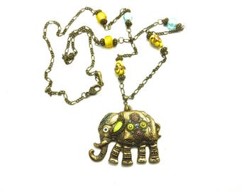 """Necklace with blue and yellow glass beads and """"impérial éléphant"""""""