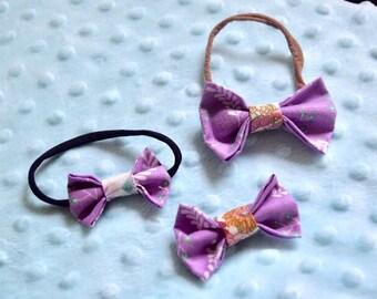 Purple flower bows