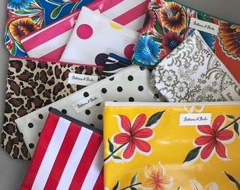 Bulk order Assorted Zippered Oil Cloth Pouches buy 10 or more & Save