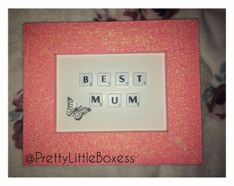 Glittery wide wooden frame with scrabble tiles