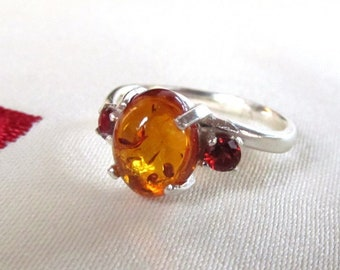 10x8mm Baltic Amber Cabochon Sterling Silver Ring Accented with Garnets