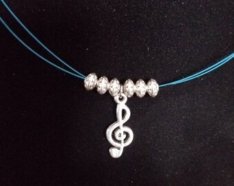 Guitar string necklace with music charm. Blue.