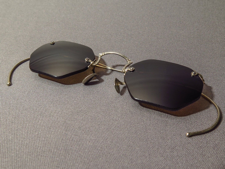 Spitmud óptico marcos antiguos plata con gris lentes