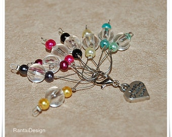 Stitch markers for knitting with progress markers