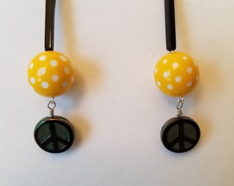 Earrings. Vintage Polka Dot and Black Cylinders accented with Czech glass iridescent peace signs. Perky.