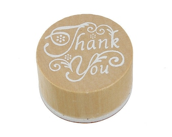"Wood and ""Thank You"" rubber stamp"