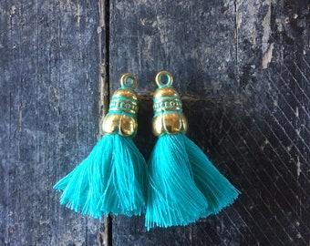 Turquoise tassel, cotton thread, metal cap oxidized green antique gold, 35x10mm, sold by 2